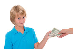 Blond boy preserve his pocket money. Dollars Stock Image