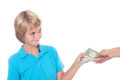 Blond boy preserve his pocket money. Dollars Stock Images