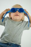 Blond Boy Putting on Goggles Stock Image