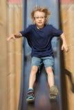 Blond boy on a slide Royalty Free Stock Photos