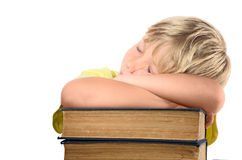 Blond boy on stack of books Royalty Free Stock Photo