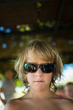 Blond boy with sunglasses. Stock Photography