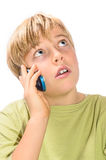 Blond boy talking on cell phone Stock Photo