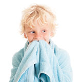 Blond boy wearing blue towel. Royalty Free Stock Photography