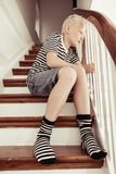 Blond boy wearing stripped shirt and socks Royalty Free Stock Images