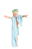 Blond boy wearing swimming shorts and swimming mask with a blue towel. Studio shot, isolated on a white background Royalty Free Stock Photo