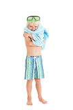 Blond boy wearing swimming shorts and swimming mask with a blue towel. Studio shot, isolated on a white background Stock Image