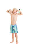 Blond boy wearing swimming shorts with swimming mask. The boy shows muscles. Studio shot, isolated on a white background Stock Photos