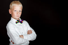 Blond boy in white shirt and rainbow bow tie Stock Photography