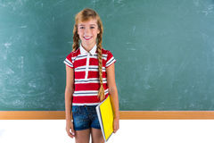 Blond braid schoolgirl with student spiral notebook Stock Images