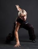 Blond breakdancer in motion. Against dark background Stock Photography