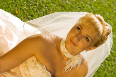 Blond Bride. Portrait of a beautiful smiling blond bride with green eyes Stock Images