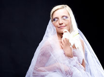 Blond bride. Beautiful young blond bride with a lily and creative makeup Royalty Free Stock Photos