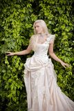 Blond bride in luxury clothes Royalty Free Stock Photo