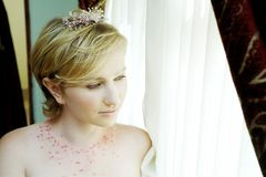 Blond bride with pink accessories royalty free stock photos