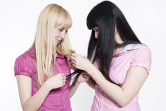 Blond and brunette Stock Photography