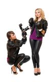 Blond and brunette with the camera Stock Image