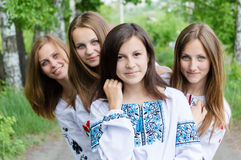 4 blond & brunette girlfriends young beautiful women having fun posing happy smile standing together in forest or park. Standing together in forest or park team Royalty Free Stock Photos