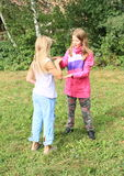 Blond and brunette girls playing Royalty Free Stock Images