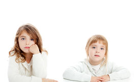 Blond and brunette kid girls portrait on white Stock Photos