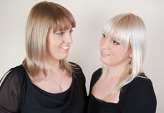 Blond and brunette sister girls Stock Photography