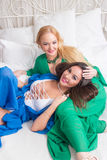Blond and brunette Woman In Bed Stock Photography
