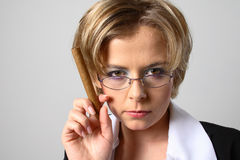 Blond business cigar woman Stock Photo