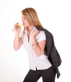 Blond business lady drinking champagne Royalty Free Stock Image