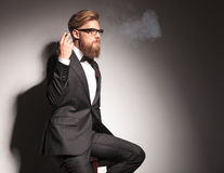 Blond business man resting on a stool Stock Photo