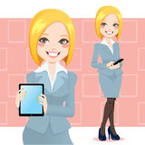 Blond Business Woman. Beautiful blond business woman using a touch pad tablet portable computer Royalty Free Stock Photo