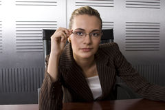 Blond business woman. Young attractive blond business woman in a modern office setting Royalty Free Stock Photography
