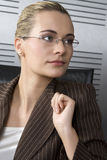 Blond business woman. Young attractive blond business woman in a modern office setting Stock Images