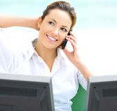 Blond business woman. With a white laptop and phone Stock Photography