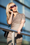 Fashion blond woman in sunglasses calling on mobile phone Royalty Free Stock Photo