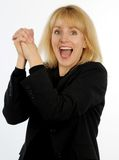 Blond business woman cheering with hands clasped together Royalty Free Stock Photo