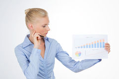 Blond business woman explaining a graphic on a chart. Beautiful girl pointed a graphic isolated on white background Stock Photo