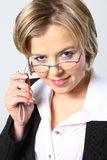 Blond business woman with glasses Stock Image