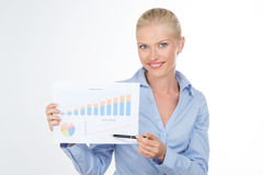 Blond business woman holding a graphic on a chart. Beautiful girl pointed a graphic growing on a board Stock Photos