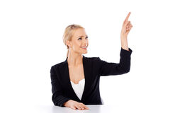 Blond business woman sitting at the desk Royalty Free Stock Photography