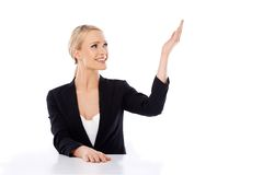 Blond business woman sitting at the desk Stock Photo
