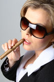 Blond business woman smoking a cigar Royalty Free Stock Image