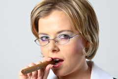 Blond business woman smoking a cigar Royalty Free Stock Images