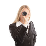 Blond business woman with spyglass Royalty Free Stock Image