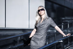 Blond business woman in sunglasses Royalty Free Stock Images
