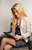 Blond business woman with tablet Stock Photos