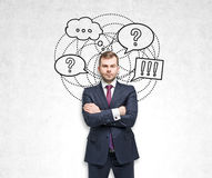 Blond businessman, questions and answers Royalty Free Stock Images