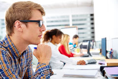 Blond businessman young in office with computer. In a desk row stock photo
