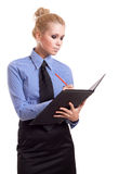 Blond businesswoman with black folder and red pen Stock Photography