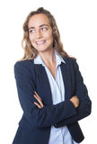 Blond businesswoman with blue eyes and blazer looking sideways Stock Photography