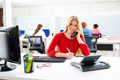 Blond businesswoman in call center working office Stock Photography